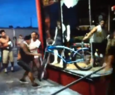 In a bystander's video, an Easyrider employee fights to keep a bike.