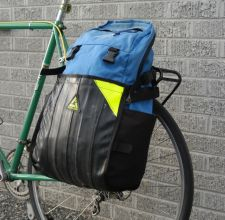 The pannier shown with a backpack inside the large pouch.