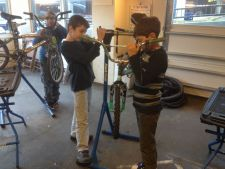 Kids at Bike Works test their skills after a class on headset repairs.