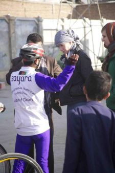 Galpin talks to a member of the Afghan national cycling team in Kabul. Photo: tony Di Zinno