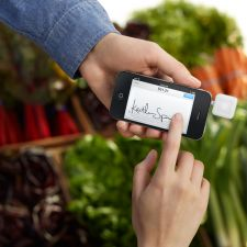 The Square register app and card scanner on an iPhone