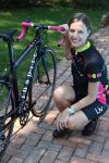 Breast cancer survivor Emily Gresh with the 2012 Liv/giant Avail Inspire she designed.