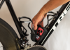 The Sicuro Capsule is a magnetically closing storage cage that bolts to the accessory ports on Sicuro carbon cages.
