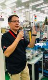Sram Asia GM/engineering manager Bob Chen shows off a mountain bike cassette.