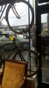 Aaron Goss integrated bikes into securing the windows of his shop in Seattle.